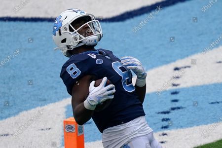 North Carolina running back Michael Carter (8) reacts after scoring against Virginia Tech during the second half of an NCAA college football game in Chapel Hill, N.C