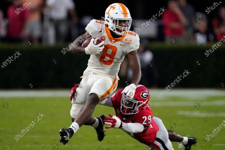 Tennessee running back Ty Chandler (8) break away from Georgia defensive back Christopher Smith (29) after a catch in the second half of an NCAA football game, in Athens, Ga