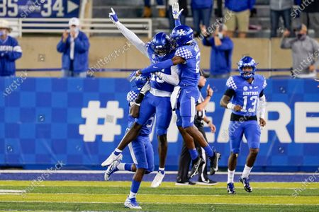 Stock Image of Kentucky linebacker Jordan Wright (15) celebrates with defensive back Quandre Mosely (21) after Wright ran an interception back for a touchdown during the second half of the team's NCAA college football game against Mississippi State, in Lexington, Ky