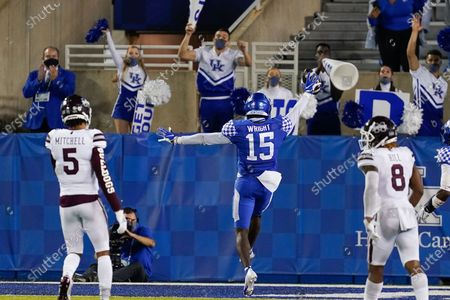 Stock Photo of Kentucky linebacker Jordan Wright (15) returns an interception for a touchdown during the second half of the team's NCAA college football game against Mississippi State, in Lexington, Ky