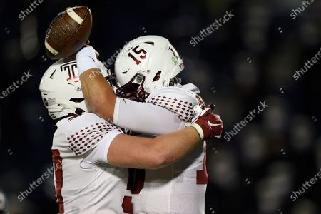 Temple's Anthony Russo, right, celebrates his touchdown against Navy with Michael Niese during the first half of an NCAA college football game, in Annapolis, Md