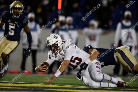 Temple quarterback Anthony Russo scores a touchdown as Navy's Kevin Brennan defends during the second half of an NCAA college football game, in Annapolis, Md