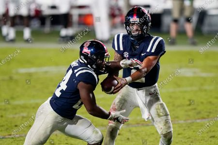 Mississippi quarterback Matt Corral (2) hands off to running back Snoop Conner (24) during the second half of the team's NCAA college football game against Alabama in Oxford, Miss., . Alabama won 63-48