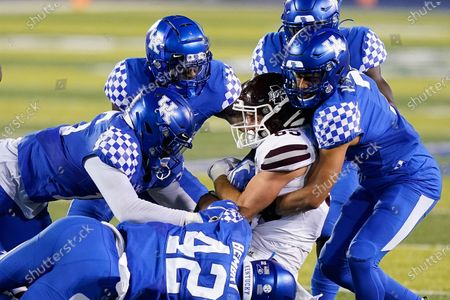 Mississippi State wide receiver Austin Williams (85) is tackled by a host of Kentucky defenders during the second half of an NCAA college football game, in Lexington, Ky
