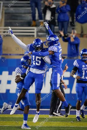 Kentucky linebacker Jordan Wright (15) celebrates with defensive back Quandre Mosely (21) after Wright ran an interception back for a touchdown during the second half of an NCAA college football game against Mississippi State, in Lexington, Ky