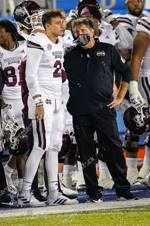 Mississippi State head coach Mike Leach and DUPLICATE***quarterback Will Rogers (2) talk during the second half of an NCAA college football game, in Lexington, Ky