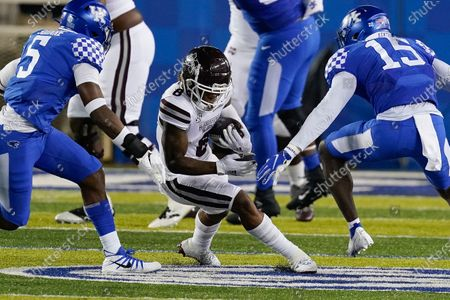 Stock Picture of Kentucky linebacker DeAndre Square (5) and linebacker Jordan Wright (15) tackle Mississippi State running back Kylin Hill (8) during an NCAA college football game, in Lexington, Ky