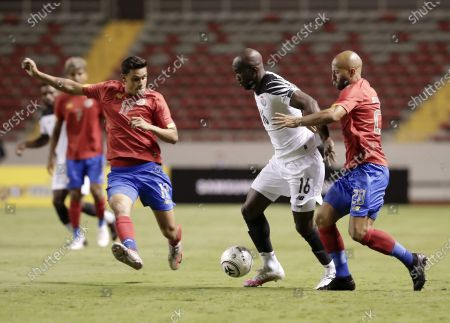 Stock Image of Ricardo Blanco (R) and Yeltsin Tejeda (L) of the Costa Rica national team vies for the ball against Cecilio Waterman (C) of the Panama national team during a friendly match between the teams of Costa Rica and Panama in San Jose, Costa Rica, 10 October 2020.