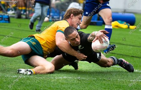 New Zealand's Aaron Smith scores a try in the tackle of Australia's Michael Hooper during the Bledisloe Cup rugby game between the All Blacks and the Wallabies in Wellington, New Zealand, Sunday, Oct.11, 2020