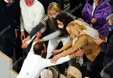 Stock Picture of Rafael Nadal is congratulated by his wife, Maria Francisca Perello, and mother, Ana María Parera, after victory in the Men's Singles final