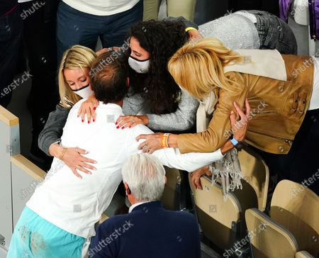 Stock Image of Rafael Nadal is congratulated by his wife, Maria Francisca Perello, and mother, Ana María Parera, after victory in the Men's Singles final