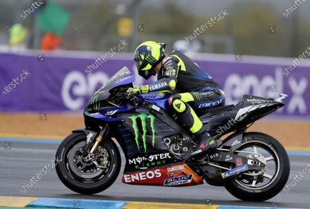 Italian rider Valentino Rossi of the Monster Energy Yamaha MotoGP steers his motorcycle during a warm up lap before the MotoGP race of the French Motorcycle Grand Prix at the Le Mans racetrack, in Le Mans, France