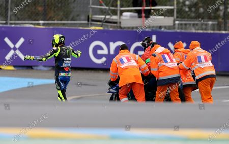 Marshals push Italian rider Valentino Rossi of the Monster Energy Yamaha MotoGP motorcycle after falls down during the MotoGP race of the French Motorcycle Grand Prix at the Le Mans racetrack, in Le Mans, France
