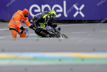 Italian rider Valentino Rossi of the Monster Energy Yamaha MotoGP after crashing during the MotoGP race of the French Motorcycle Grand Prix at the Le Mans racetrack, in Le Mans, France
