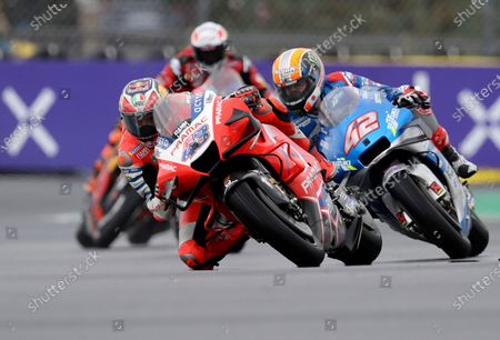 Australian rider Jack Miller of the Pramac Racing steers his motorcycle followed by Spain's rider Alex Rins of the Team SUZUKI ECSTAR during the MotoGP race of the French Motorcycle Grand Prix at the Le Mans racetrack, in Le Mans, France
