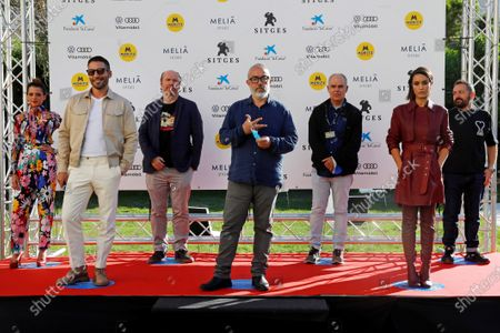 Alex de la Iglesia (C), screenwriter Jorge Guerricaechevarria (3-L), HBO Espana commissioning editor Miguel Salvat (3-R), and actors Macarena Gomez (2-L), Megan Montaner (R), Miguel Angel Silvestre (L), and Pepon Nieto (2-L) pose during the presentation of the HBO series '30 Monedas' at the 53rd Sitges International Fantastic Film Festival of Catalonia, in Sitges, Spain, 11 October 2020. The festival runs from 08 October to 18 October 2020.