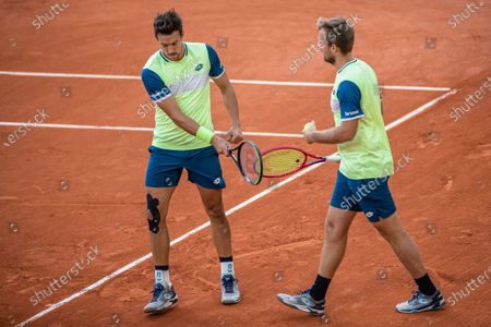 Kevin Krawietz and Andreas Mies (L) of Germany react during the men's doubles final match between Kevin Krawietz and Andreas Mies of Germany and Mate Pavic of Croatia and Bruno Soares of Brazil at the French Open tennis tournament 2020 in Paris, France, Oct. 10, 2020.