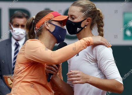 Kristina Mladenovic of France (R) and Timea Babos of Hungary react after winning against Alexa Guarachi of Chile and Desirae Krawczyk of the USA in their women's doubles final match during the French Open tennis tournament at Roland Garros in Paris, France, 11 October 2020.