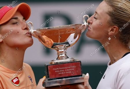 Kristina Mladenovic of France (R) and Timea Babos of Hungary kissing their trophy after winning against Alexa Guarachi of Chile and Desirae Krawczyk of the USA in their women's doubles final match during the French Open tennis tournament at Roland Garros in Paris, France, 11 October 2020.