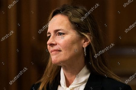 Supreme Court nominee Judge Amy Coney Barrett, listens as Sen. Steve Daines, R-Mont., speaks during their meeting on Capitol Hill in Washington. A scant two weeks after her nomination, Judge Amy Coney Barrett goes before a Senate committee that's bitterly split along partisan lines over whether the Supreme Court vacancy created by Justice Ruth Bader Ginsburg's death should be filled now or should await the winner of the Nov. 3 presidential election