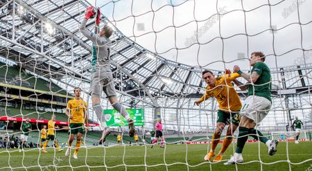 Republic of Ireland vs Wales. Wales' Wayne Hennessy claims a high ball as Connor Roberts and James McClean of Ireland tangle