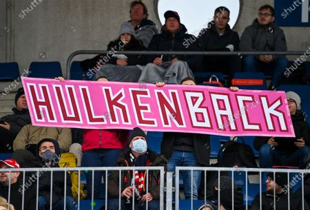 Stock Photo of Formula fans hold a banner reading 'Hulkenback' in reference to the return of German driver Nico Huelkenberg prior to the Formula One Eifel Grand Prix at the Nuerburgring race track in Nuerburg, Germany, 11 October 2020