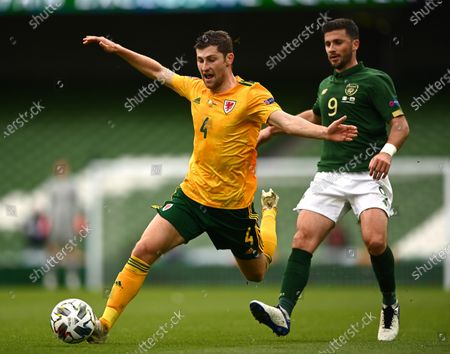 Ben Davies of Wales is tackled by Shane Long of Republic of Ireland.