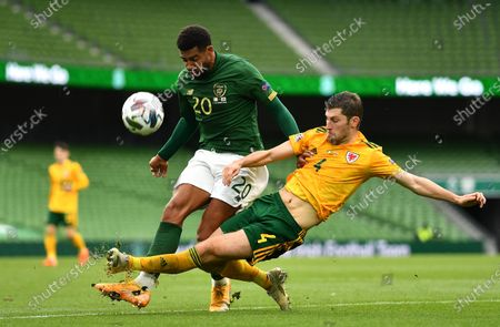 Cyrus Christie of Republic of Ireland is tackled by Ben Davies of Wales.