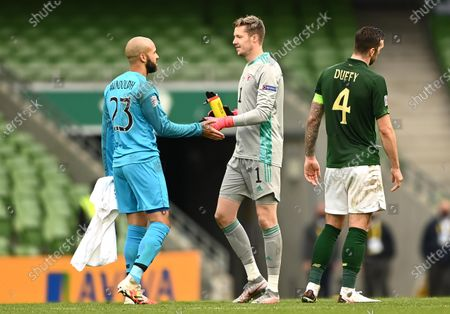 Darren Randolph of Republic of Ireland and Wayne Hennessey of Wales at the end of the game.
