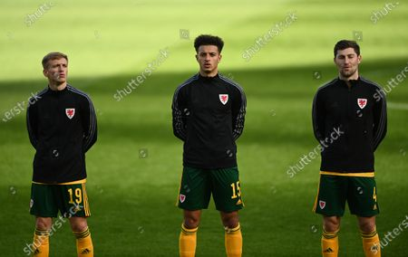 Matthew Smith, Ethan Ampadu and Ben Davies of Wales during the anthems.