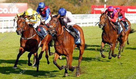 ONASSIS (centre, Hayley Turner) beats WITH THANKS (left) in The British EBF October Fillies Stakes Goodwood