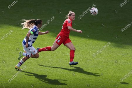Rebecca Holloway of Birmingham City and Natasha Harding of Reading chase the ball