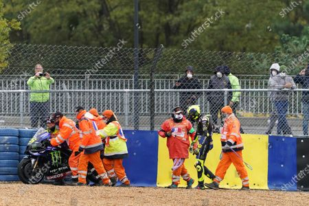 Italian MotoGP rider Valentino Rossi (2-R) of Monster Energy Yamaha Moto GP reacts after falling during the motorcycling Grand Prix of France in Le Mans, France, 11 October 2020.