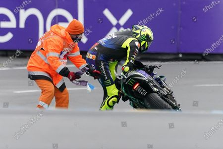 Italian MotoGP rider Valentino Rossi (R) of Monster Energy Yamaha Moto GP reacts after falling during the motorcycling Grand Prix of France in Le Mans, France, 11 October 2020.