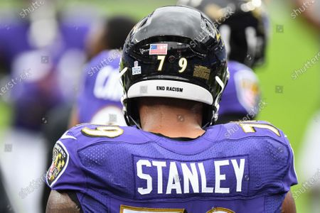 Baltimore Ravens offensive tackle Ronnie Stanley (79) has End racism written on the back of helmet before an NFL football game against the Cincinnati Bengals, in Baltimore