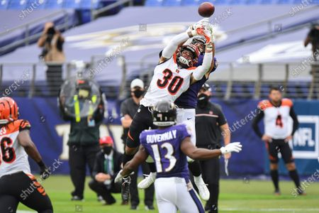 Stock Image of Cincinnati Bengals free safety Jessie Bates (30) breaks up a pass against Baltimore Ravens tight end Mark Andrews (89) during the first half of an NFL football game, in Baltimore