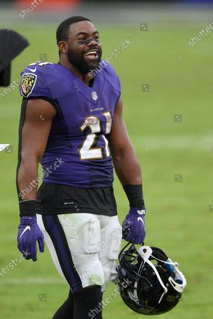 Baltimore Ravens running back Mark Ingram (21) stands on the field after an NFL football game against the Cincinnati Bengals, in Baltimore. The Ravens won 27-3