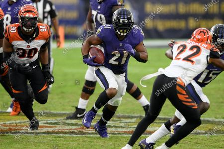 Baltimore Ravens running back Mark Ingram (21) runs with the ball during the second half of an NFL football game against the Cincinnati Bengals, in Baltimore
