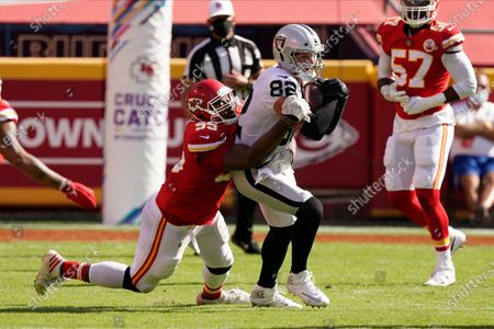 Las Vegas Raiders tight end Jason Witten (82) is brought down by Kansas City Chiefs defensive tackle Chris Jones (95) after a catch during the second half of an NFL football game, in Kansas City