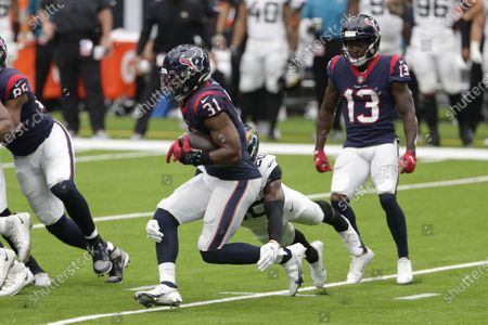 Houston Texans running back David Johnson (31) runs past Jacksonville Jaguars safety Daniel Thomas (20) during the second half of an NFL football game, in Houston
