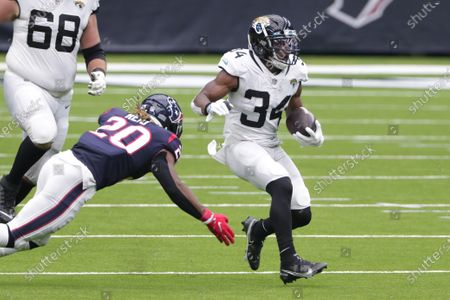 Jacksonville Jaguars running back Chris Thompson (34) runs past Houston Texans strong safety Justin Reid (20) during the second half of an NFL football game, in Houston