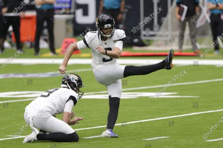 Jacksonville Jaguars kicker Stephen Hauschka (3) kicks during the first half of an NFL football game against the Houston Texans, in Houston