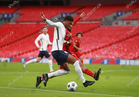 England's Marcus Rashford, left, is challenged by Belgium's Jason Denayer during the UEFA Nations League soccer match between England and Belgium at Wembley stadium in London