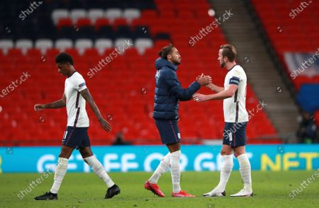 England's Marcus Rashford, England's Dominic Calvert-Lewin and England's Harry Kane, from left, leave the field after the UEFA Nations League soccer match between England and Belgium at Wembley stadium in London, . England won the match 2-1