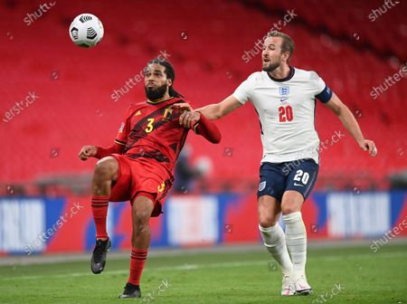 England's Harry Kane, right, challenges Belgium's Jason Denayer during the UEFA Nations League soccer match between England and Belgium at Wembley stadium in London