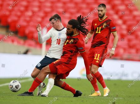 Mason Mount of England (L) in action against Jason Denayer  of Belgium (C) during the UEFA Nations League match between England and Belgium in London, Britain, 11 October 2020.