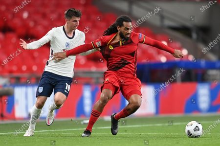Mason Mount of England (L) in action against Jason Denayer  of Belgium (R) during the UEFA Nations League match between England and Belgium in London, Britain, 11 October 2020.
