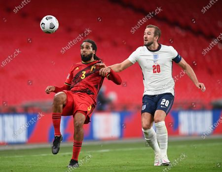 Harry Kane of England (R) in action against Jason Denayer of Belgium (L) during the UEFA Nations League match between England and Belgium in London, Britain, 11 October 2020.