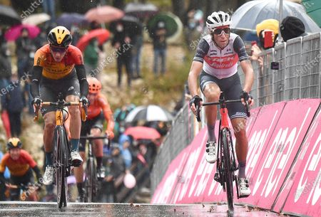 Italian rider Vincenzo Nibali (R) of Trek Segafredo team crosses the finish line during the 9th stage of the 2020 Giro d'Italia cycling race over 208km from San Salvo to Roccaraso, Italy, 11 October 2020.