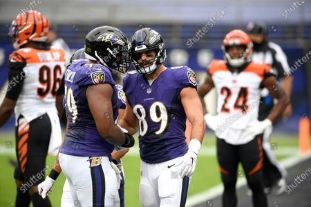 Baltimore Ravens tight end Mark Andrews (89) is congratulated by offensive tackle Ronnie Stanley (79) after catching a touchdown pass from quarterback Lamar Jackson, not visible, during the first half of an NFL football game against the Cincinnati Bengals, in Baltimore